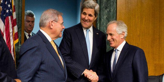 UNITED STATES - DECEMBER 9: From left, chairman Bob Menendez, D-N.J., Secretary of State John Kerry and ranking member Bob Co