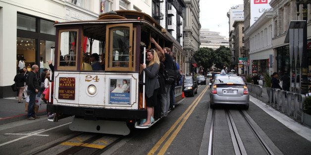View of a cable car on Powell Street as it crosses the intersection with O'Farrell, San Francisco, California, July 16, 2014.