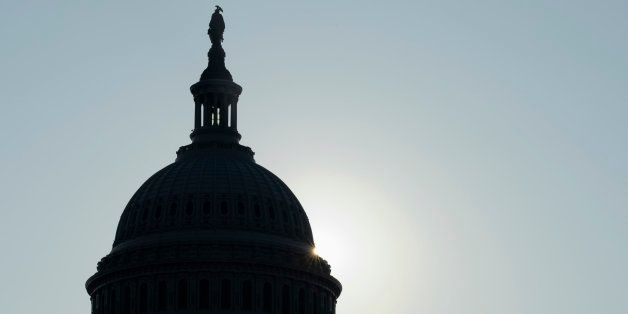 The sun peeks from behind the Capitol dome on Capitol Hill in Washington, Friday, Oct. 4, 2013, as the budget battle continue