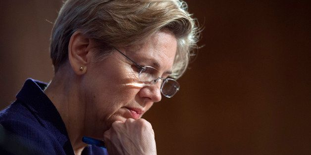 Sen. Elizabeth Warren, D-Mass., pauses while questioning a witness at Senate Banking Committee hearing on anti-money launderi