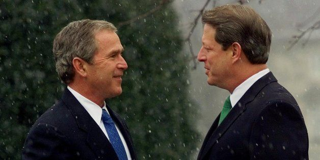 Vice President Gore greets President-elect Bush, as the snow falls outside the vice president's residence, prior to their mee