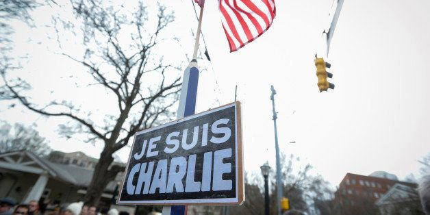 "A sign reading ""Je Suis Charlie"" (I am Charlie) is on display during a silent walk in Atlanta, Sunday, Jan. 11, 2015, to supp"