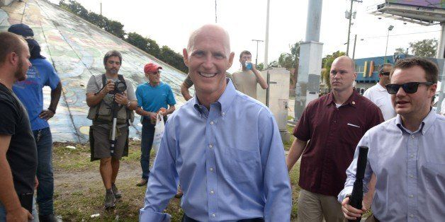 MIAMI, FL - JANUARY 11: Governer Rick Scott participates in Three Kings Parade in Miami's Little Havana on January 11, 2015 i