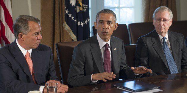 US President Barack Obama (C) speaks alongside Speaker of the House John Boehner (L), Republican of Ohio, and Senate Majority