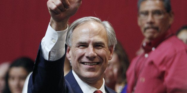 AUSTIN, TX - NOVEMBER 4:  Texas Governor-elect Greg Abbott celebrates during his victory party on November 4, 2014 in Austin,