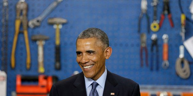 President Barack Obama smiles as he speaks at Cedar Falls Utilities, Wednesday, Jan. 14, 2015, in Cedar Falls, Iowa. Presiden
