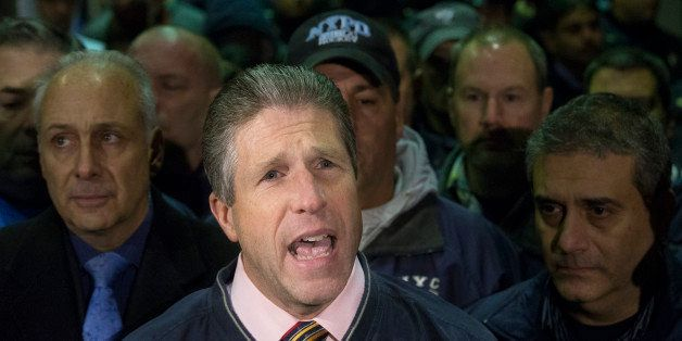 Patrick Lynch, head of the Patrolmen's Benevolent Association, speaks during a news conference after the bodies of two fallen