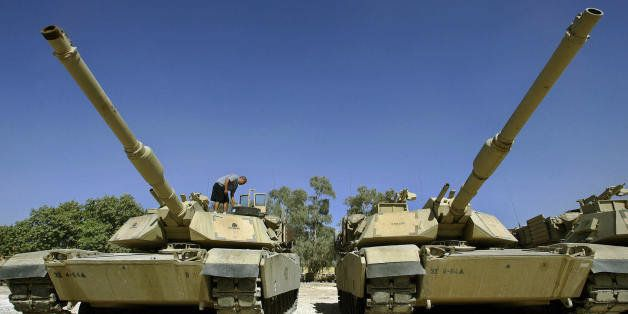 BAGHDAD, Iraq:  A US soldier of Delta Company, Task Force 4-64 Armor, works on the M1 Abrams Tanks at Camp Prosperity, in Bag