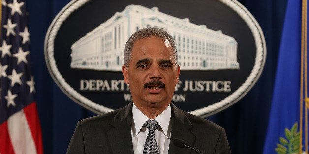 WASHINGTON, DC - DECEMBER 03:  U.S. Attorney General Eric Holder speaks at the Justice Department December 3, 2014 in Washing