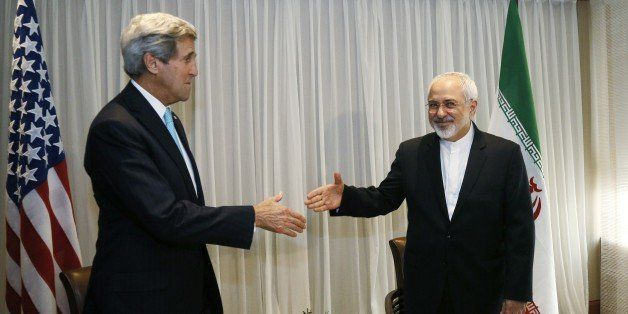 Iranian Foreign Minister Mohammad Javad Zarif (R) shakes hands on January 14, 2015 with US State Secretary John Kerry in Gene