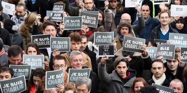 French residents hold signs reading 'Je suis Charlie' (I am Charlie), to pay tribute to the victims of the Charlie Hebdo atta