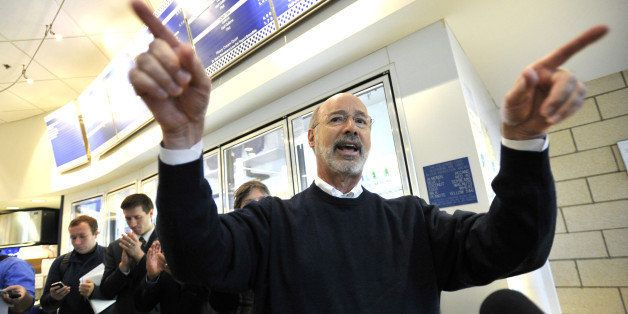 Democratic candidate for Pennsylvania Governor Tom Wolf talks to a crowd of people inside the Berkey Creamery on Wednesday, O