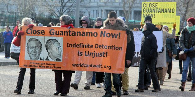 WASHINGTON, DC - JANUARY 11: Protesters rally outside of the White House to protest Guantanamo Bay on the 13th anniversary of