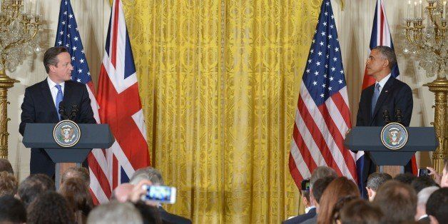 US President Barack Obama (R) and Britain's Prime Minister David Cameron hold a press conference in the East Room of the Whit