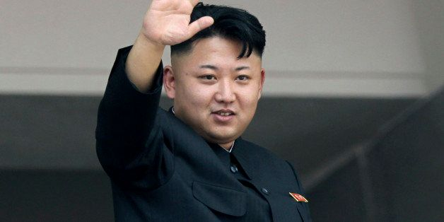 FILE - In this July 27, 2013 file photo, North Korea's leader Kim Jong Un waves to spectators and participants of a mass mili