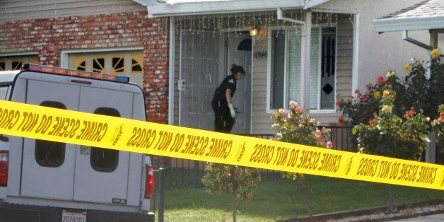 Crime scene tape is seen in front of the home Wednesday, Oct. 24, 2012, where a mother and her two young children were found