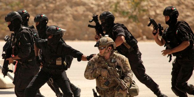 FILE - In this Thursday, June 20, 2013 photo, special operations forces from Iraq, Jordan and the U.S. conduct an exercise as