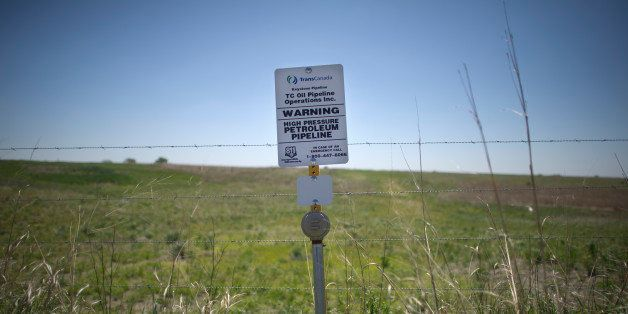 A sign marks the ground covering TransCanada's Keystone I pipeline outside of Steele City, Nebraska. The Keystone XL pipeline