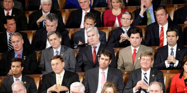 Republican members of Congress listen during President Baracl Obama's State of the Union address before a joint session of Co
