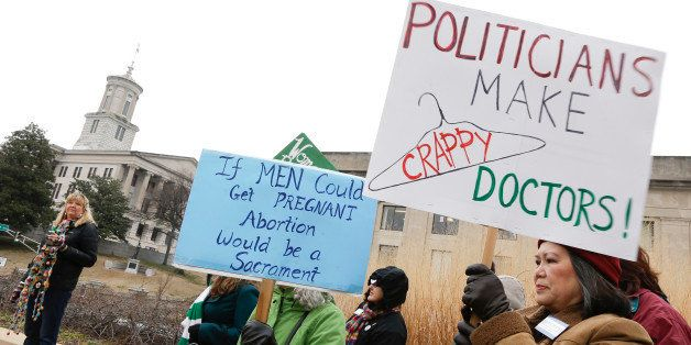 Meryl Woo Rice, right, takes part in an abortion rights protest near the Capitol on the opening day of the second session of