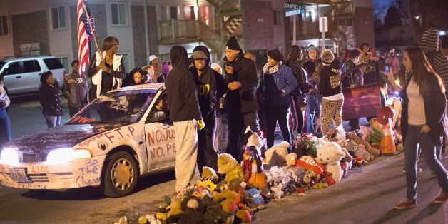FERGUSON, MO - JANUARY 19:  Demonstrators protest next to the Michael Brown memorial on Martin Luther King Jr. Day January 19