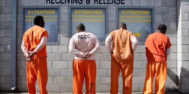 In this photo taken Thursday, Feb. 20, 2014, prisoners from Sacramento County await processing after arriving at the Deuel Vo