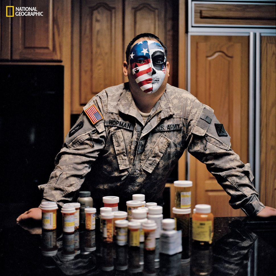 Army Staff Sgt. Perry Hopman Iraq 2006-08 Wearing his mask—half patriotic, half death's-head—Hopman confronts the battery of