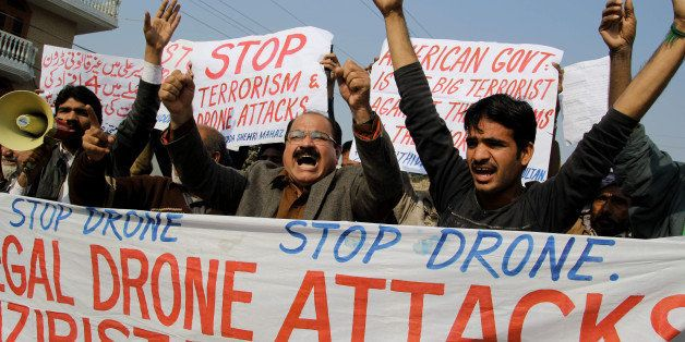Activists from the Muttahida Shehri Mahaz shout slogans as they protest against a US drone attack in Multan on December 26, 2