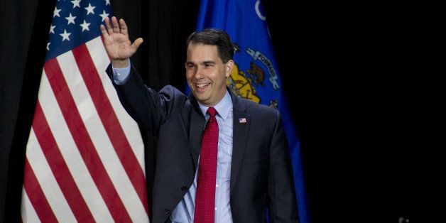 WEST ALLIS, WI - NOVEMBER 4: Wisconsin Gov. Scott Walker greets supporters at his election night party November 4, 2014 in We