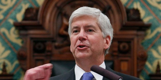 FILE - In this Jan. 20, 2015 file photo, Michigan Gov. Rick Snyder delivers his State of the State address to a joint session