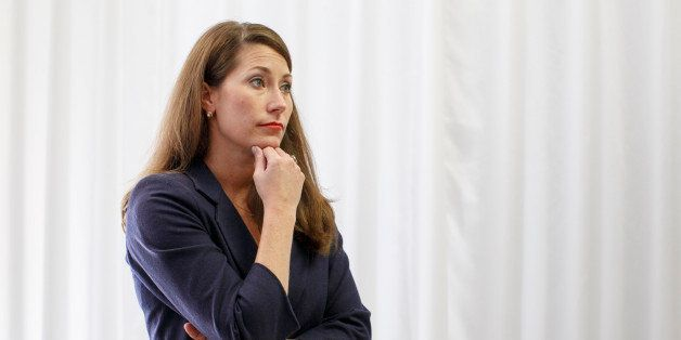 On the eve of a fateful midterm election, Kentucky's Democratic candidate for the Senate, Alison Lundergan Grimes, pauses bef