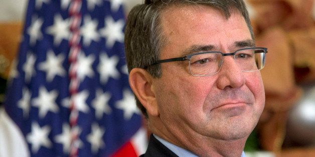 Ashton Carter listens as President Barack Obama announces he will nominate Carter for defense secretary, Friday, Dec. 5, 2014