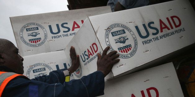 HARBEL, LIBERIA - AUGUST 24:  Workers unload medical supplies to fight the Ebola epidemic from a USAID cargo flight on August
