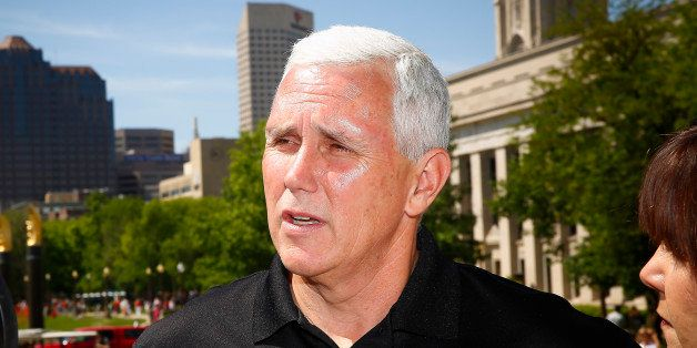 INDIANAPOLIS, IN - MAY 24: Indiana governor Mike Pence attends the 2014 IPL 500 Festival Parade during the 2014 Indy 500 Fest
