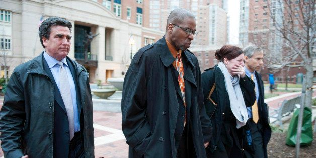 Former CIA officer Jeffrey Sterling, second from left, leaves the Alexandria Federal Courthouse Monday, Jan. 26, 2015, in Ale