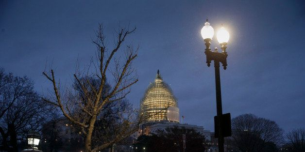 The Capitol in Washington is seen just before dawn as freezing temperatures and snow delay government agencies from opening o