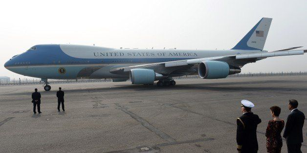 The US embassy defence attache salutes as the Air Force One aircraft prepares to taxi with US President Barack Obama and his