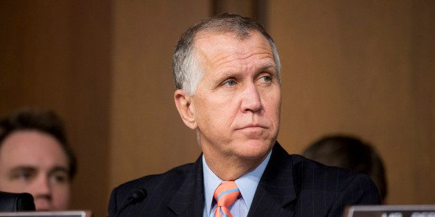 UNITED STATES - JANUARY 28: Sen. Thom Tillis, R-N.C., listens as U.S. Attorney General nominee Loretta Lynch testifies during