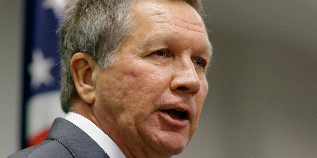 FILE - In this Oct. 18, 2013 file photo, Ohio Gov. John Kasich speaks in Cleveland. Partisan politics are coloring governorsâ