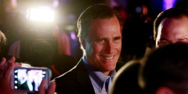 SAN DIEGO, CA - JANUARY 16: Mitt Romney is greeted by fellow Republicans at a dinner during the Republican National Committee