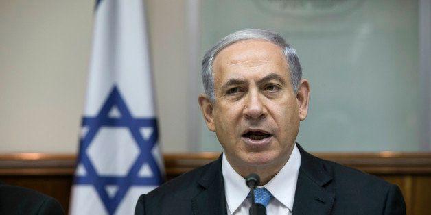 Israeli Prime Minister Benjamin Netanyahu attends the weekly cabinet meeting in his Jerusalem office, Sunday, Jan. 25, 2015.