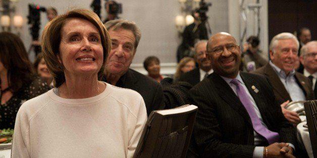 US House Minority Leader Nancy Pelosi (L), her husband Paul Pelosi (2nd L), Philadelphia Mayor Michael Nutter (2nd R) and Hou