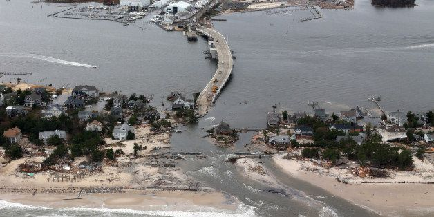 FILE - This Oct. 31, 2012 file aerial photo shows storm damage from Sandy over the Atlantic Coast in Mantoloking, N.J. Climat