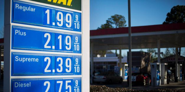In this Sunday, Jan. 25, 2015 photo, a gas station advertises their prices for passing motorists in Atlanta. (AP Photo/David