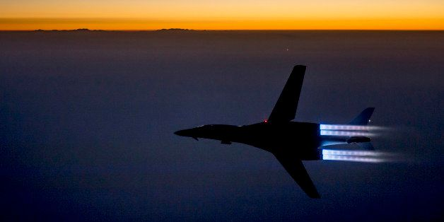 In this Saturday, Sept. 27 photo released by the U.S. Air Force, a fighter jet flies over northern Iraq after conducting airs