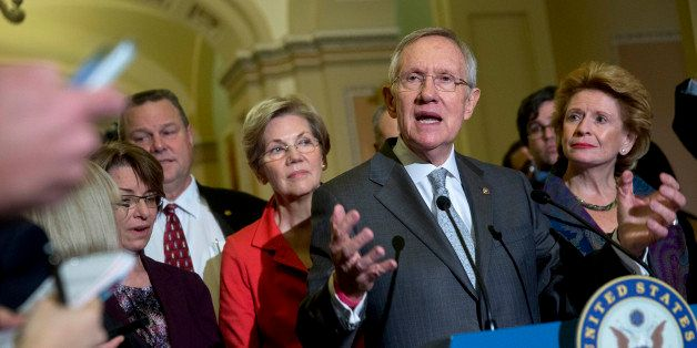 Senate Majority Leader Harry Reid, a Democrat from Nevada, speaks during a news conference with fellow Senate Democrats, from