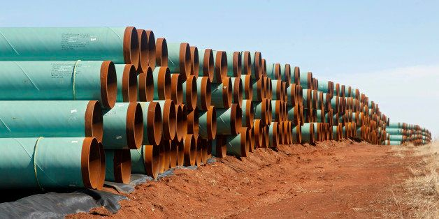 FILE - In this Feb. 1, 2012 file photo, miles of pipe ready to become part of the Keystone Pipeline are stacked in a field ne