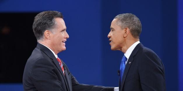 US President Barack Obama shakes hands with Republican presidential candidate Mitt Romney at the end of the third and final p