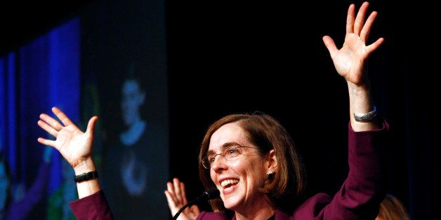 Oregon Democratic Secretary of State Kate Brown celebrates at the podium after winning her race at Democratic headquarters in