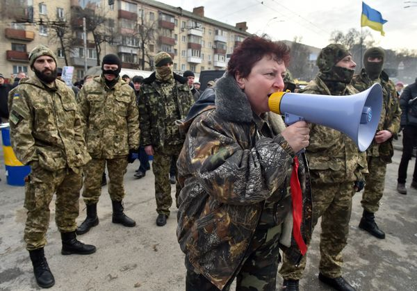 Fighters of the Aydar Ukrainian volunteer battalion, demonstrate at the entrance to the Ukrainian Defence Ministry in Kiev, o